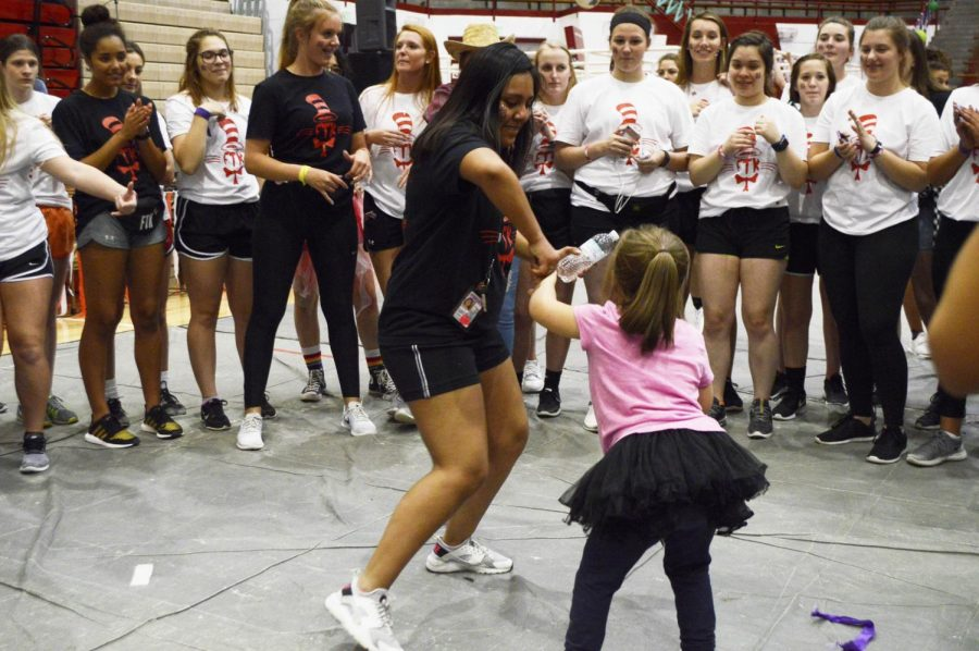 Junior Alondra Arriaga-Rosales dances with Riley patient Lily Garner. Every year, RDM dancers include patients in the activities, since it is
