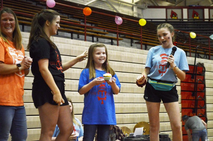 Junior Anna Kendrick (left) stands on stage with her sister Avery, who has Cystic Fibrosis. Avery explained her condition to the crowd and in return was given a birthday cupcake as she turned 8 the day of RDM.