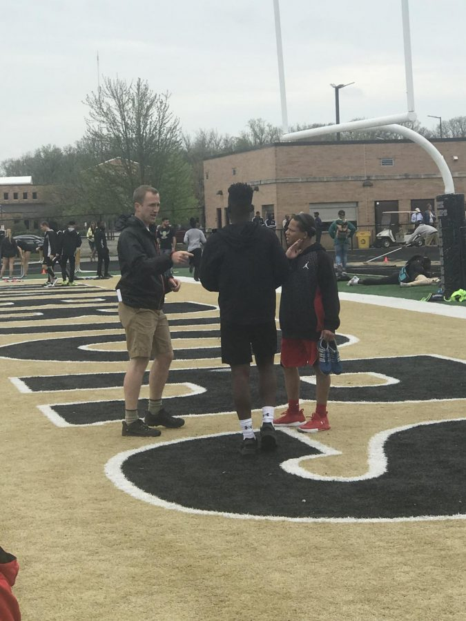 Head sprint coach Andrew Geller talks to sophomore LaMarco Yates (middle) and junior Antwuan Payne before their race on May 3 at the Warren Central Relays.