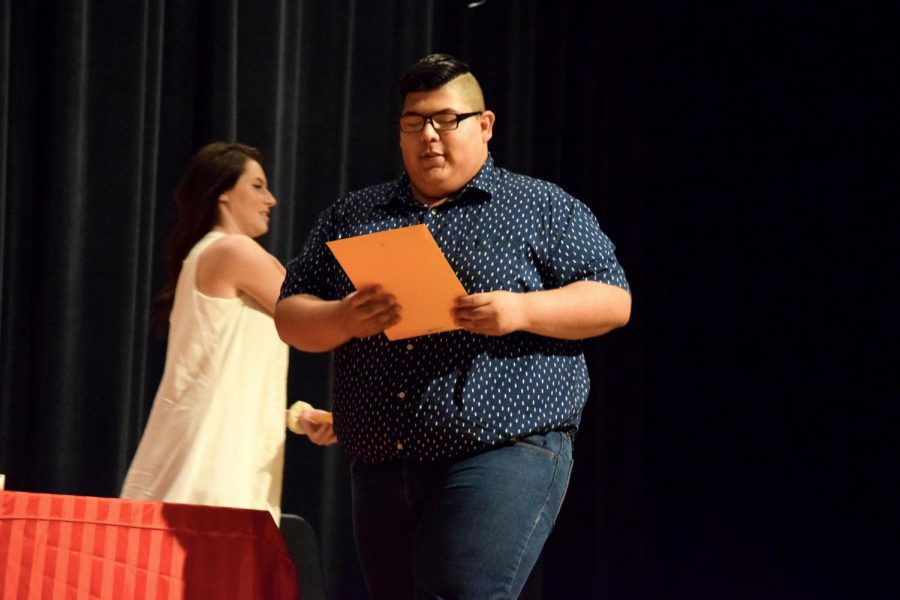 Senior Hairo Rivas receives the theater letter and certificate of thespian honor at the ceremony.