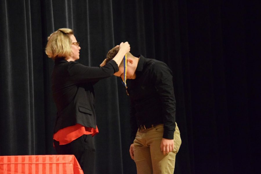 Senior Zach Smith receives national honor at Thespian Induction. Smith also received a certificate of thespian honor.