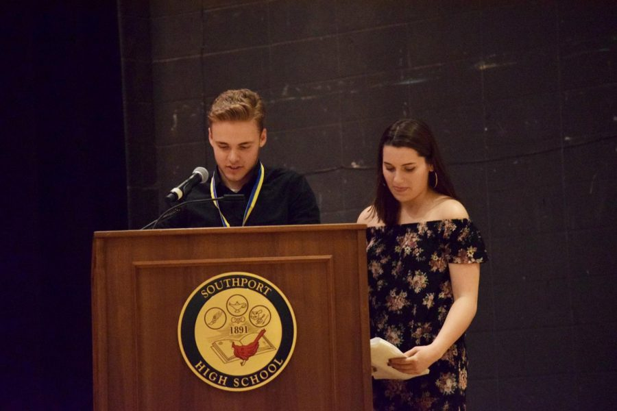 Seniors Zach Smith and Alicia May give a speech to all the new inductees.