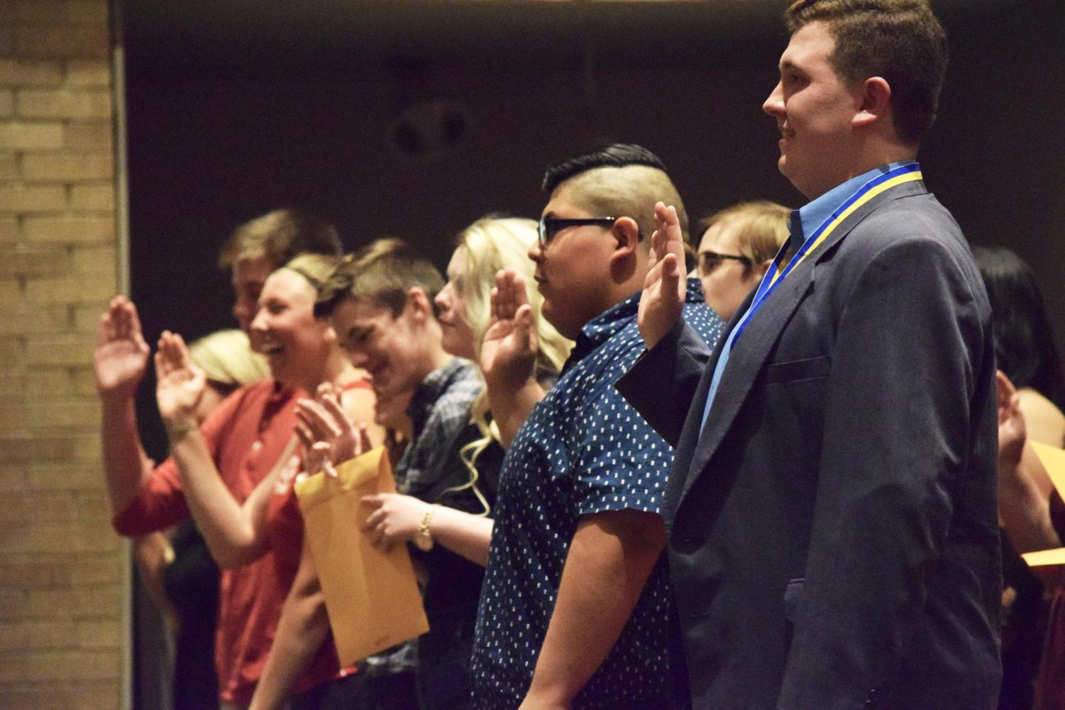 Inductees take the Thespian Society oath at the end of the ceremony on Friday, May 11.