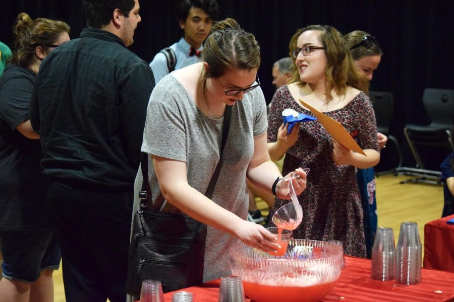 Junior Mary Miller pours herself a refreshment at the post induction reception.