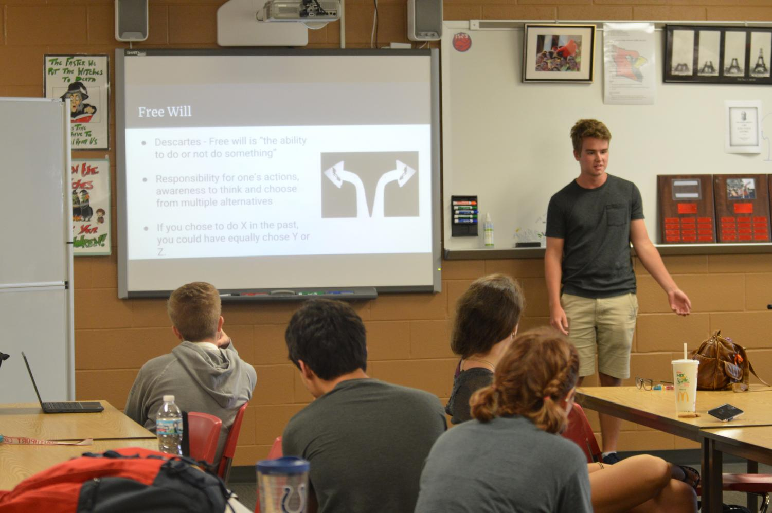 Co-founder senior John Gunderson talks to students about what to expect this year in philosophy club on Tuesday, Aug. 14.