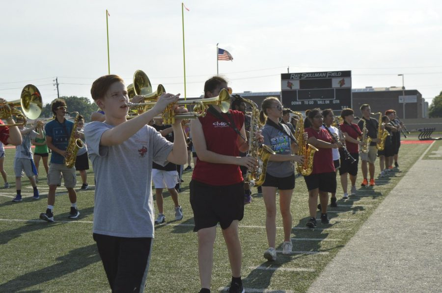 The+SHS+marching+band+practices+outside+on+the+football+field+on+Aug.+9.+They+will+be+performing+during+the+halftime+show+at+the+home+football+game+on+Friday%2C+Aug.+17.