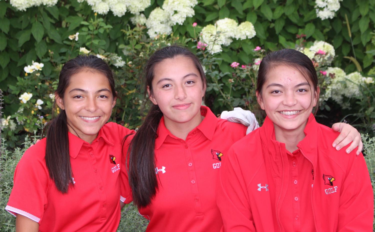 Naomi (left), Sophia (middle) and Annika Chan are triplets that are all a part of SHS girls golf team. These three don't let the competition of being on the same team affect their relationship as sisters.