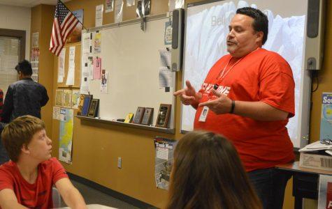SHS teacher Joseph Leonard talks to student during class. Leonard has been teaching at SHS for 15 years.