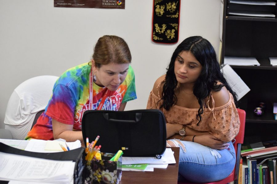 EL Department Chair Amy Peddie works with senior Gabriela Nava Cardona during iPass on Tuesday, Aug. 21.  Peddie invites EL students to her iPass for help with college and career goals.