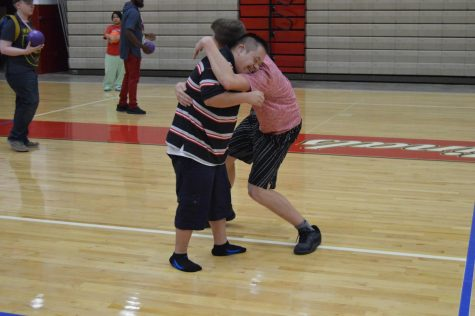 Junior Abel Tajonar (left) and sophomore Nathan Taylor (right) hug during an activity in their PE class on Aug. 10.