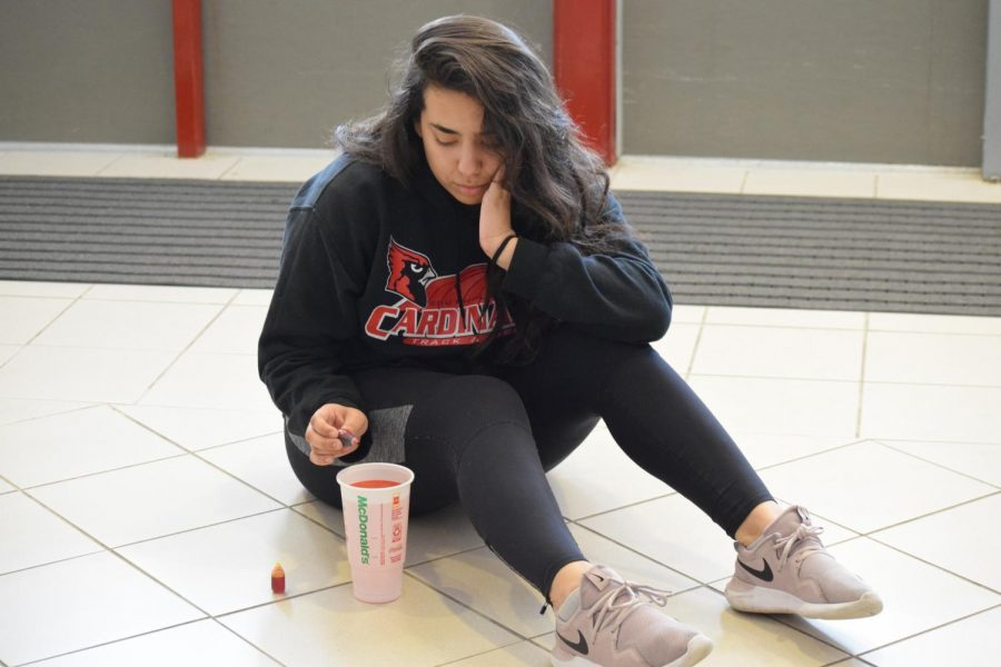 Sophomore Francis Salmon pours food coloring into her Sprite from McDonald's to imitate Hi-C.