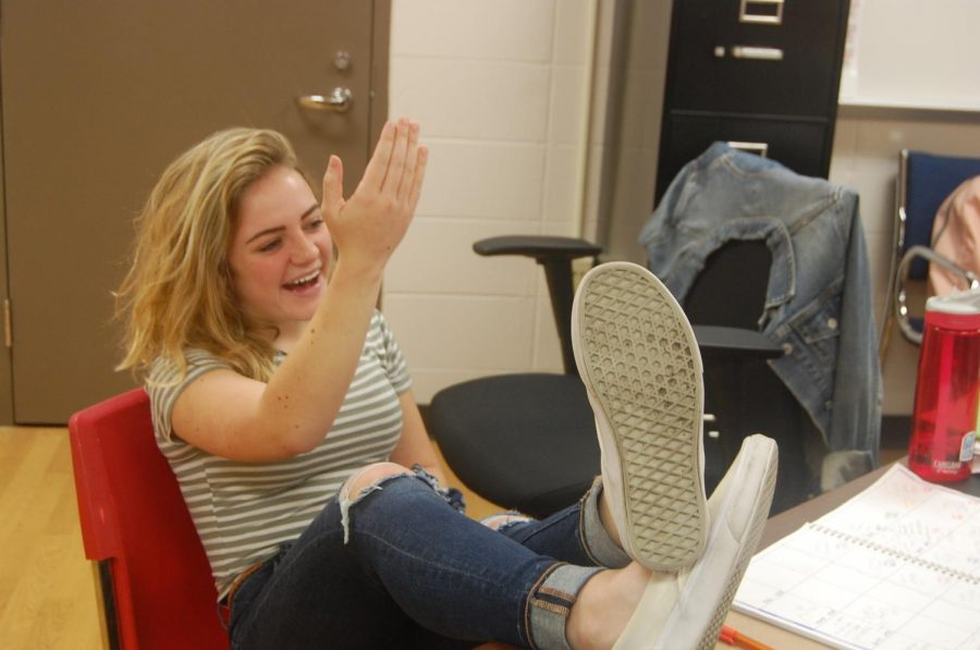 Freshman Jenn Jedford critiques her English teacher, Bob Bedford during block RW2 on Aug. 29.