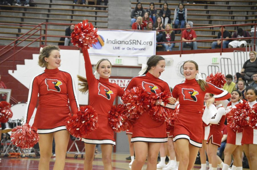 The senior cheer leaders walk across the floor and wave to their fellow classmates at the first SHS pep rally of the 2018-19 school year. The pep session took place on Friday, Aug. 17.
