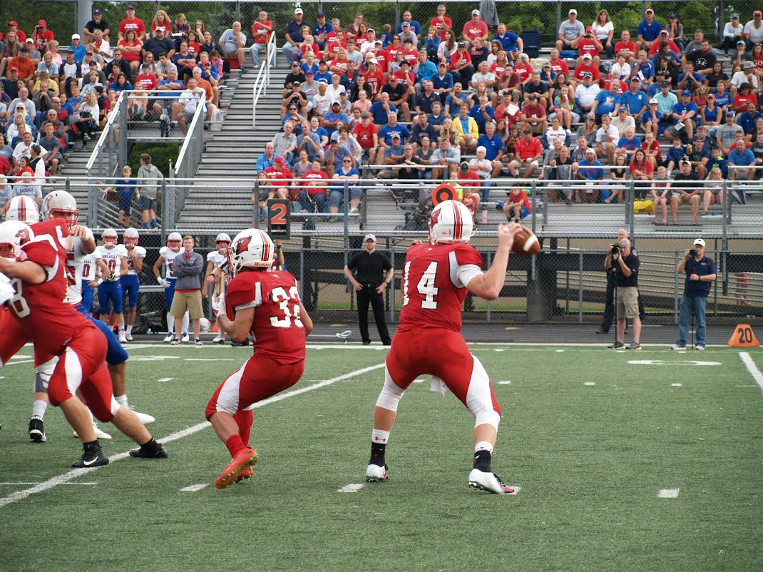 Senior+Eddie+Schott+throws+the+ball+against+Roncalli.+He+threw+for+311+total+yards+during+this+game.+