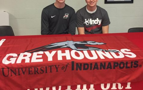 Junior Colbi Cocherell (right) smiles for a picture with his brother Hunter, who signed to the University of Indianapolis.