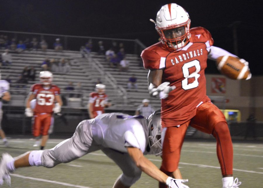 Senior Rashawn Haskins breaks a tackle during the homecoming game against Terre Haute North on Sept 21.