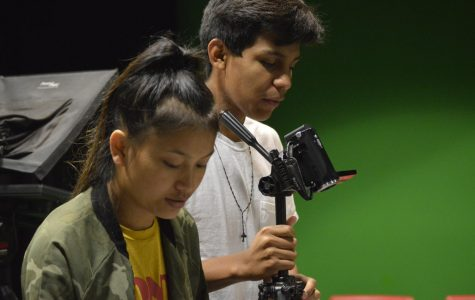 Senior Chin Chin (left) and junior Edwardo Casimiro Vega (right) work together in the Mass Media class. This is the second year for Mass Media.