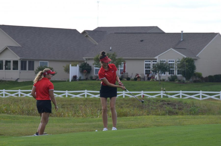 Seniors Rachel Woodson (left) and Zoe Ozolins compete in the girls golf teams competition against Perry Meridian on Sept. 11. SHS won the match.