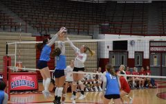 Senior Rachel Dean attempts to block a Perry Meridian player. SHS lost 3-0.