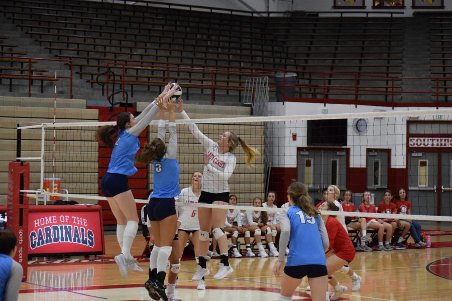 Senior+Rachel+Dean+attempts+to+block+a+Perry+Meridian+player.+SHS+lost+3-0.