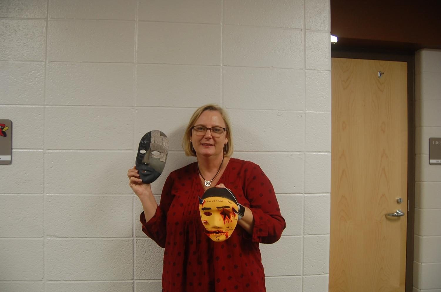 English teacher Julie Breeden assigned the pictured masks as a student project, which will be the subject of her presentation at the National Council of Teachers of English.
