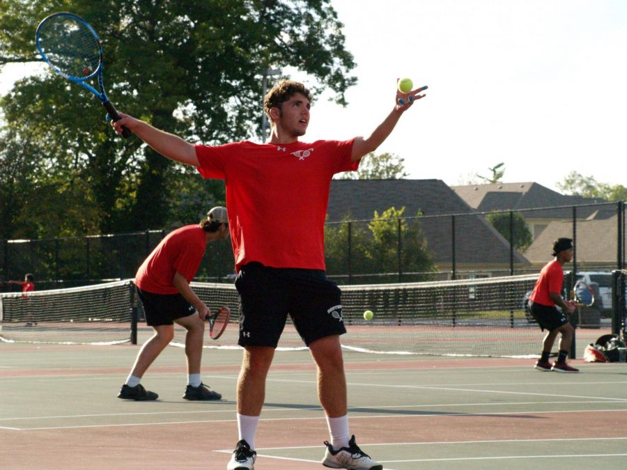 Senior Zachary Bozarth serves the ball against his Roncalli opponent on Sept. 5. SHS won the match 3-2.