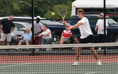 Senior John Gunderson plays in the SHS boys tennis game facing Perry Meridian. SHS won 3-2 on Sept. 6.