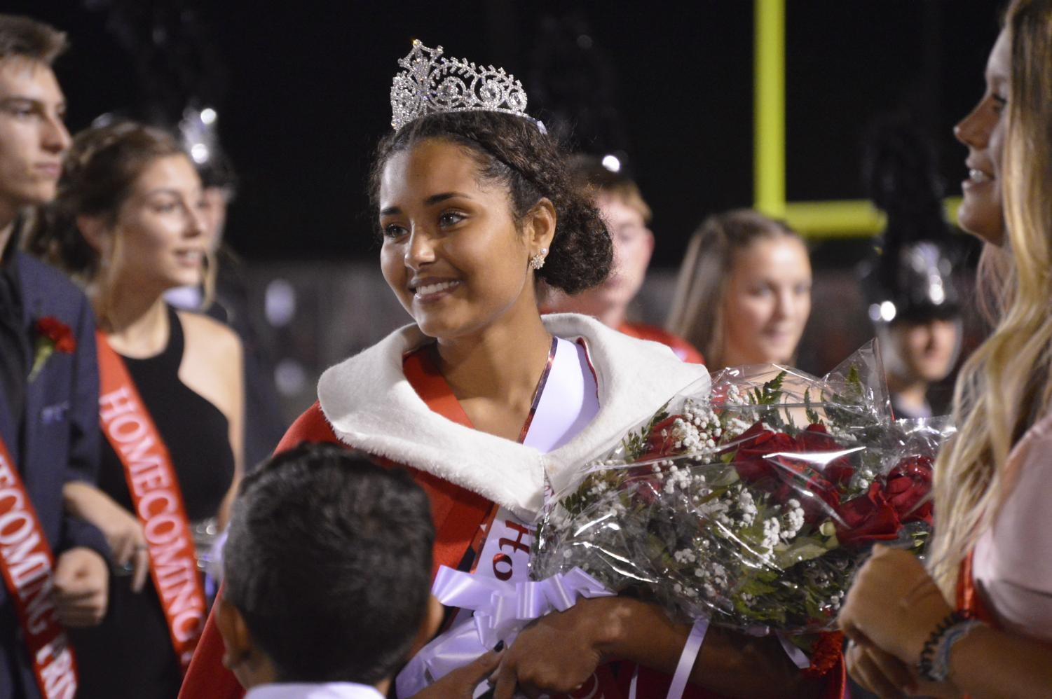 Senior Yasmin McClellan is crowned homecoming queen at the football game against Bloomington South on Fri. Sept. 21.