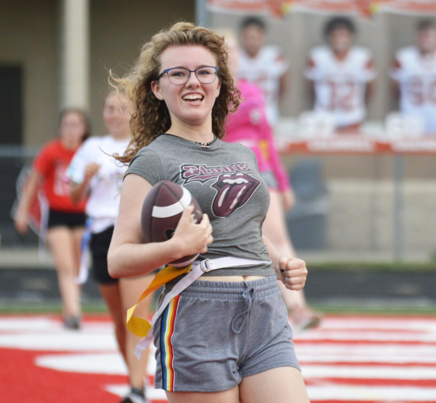 Junior Alexa Haines celebrates after scoring a touchdown for the junior powder-puff team on Tuesday, Sep. 17.