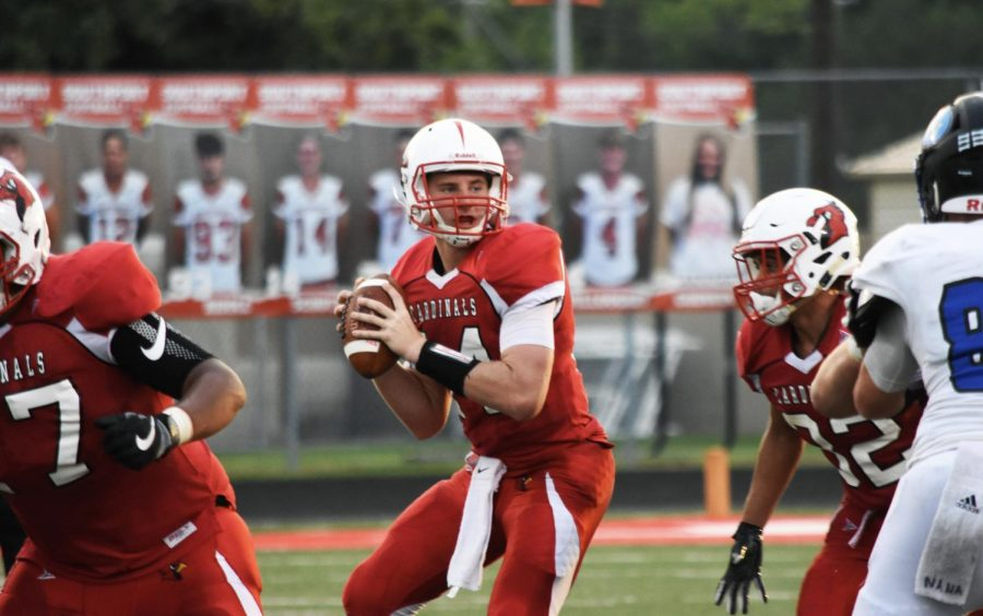 Senior+quarterback+Eddie+Schott+prepares+to+throw+the+ball+to+senior+receiver+Rashawn+Haskins%2C+ending+in+a+touchdown+for+the+Cardinals+on+Friday%2C+Aug.+31.