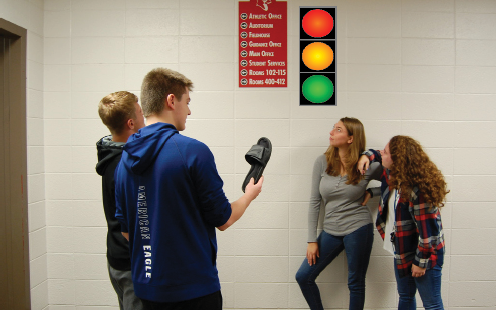 Confused students try to make out new traffic sign in the hallway on Sept. 10. The new signs were placed to quicken the traffic flow in the halls.