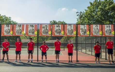 The seniors of the boys tennis team line up under their banners on Sept. 17, which was the team's senior night.