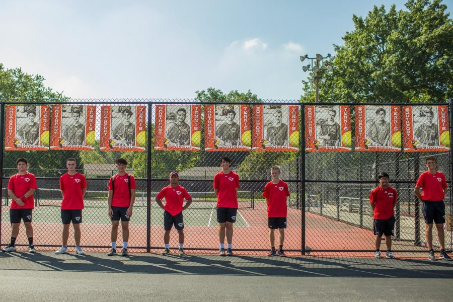 The+seniors+of+the+boys+tennis+team+line+up+under+their+banners+on+Sept.+17%2C+which+was+the+team%27s+senior+night.