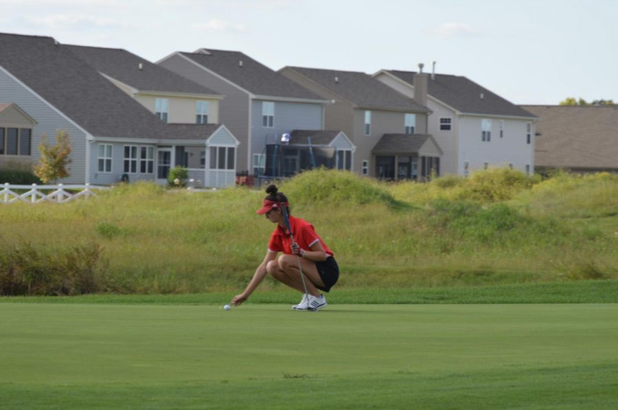Senior Zoe Ozolins makes a putt during SHSs match against Perry Meridian on Sept. 11.
