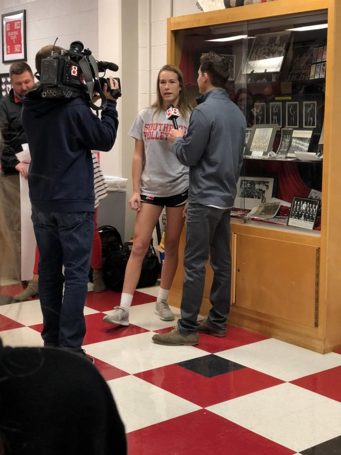 Junior volleyball player Lauren Cullison responds to sports anchor Charlie Clifford in an interview at a celebration of her award. Cullison was not only named athlete of the month by WISH TV, but was awarded $1000 in scholarship money.