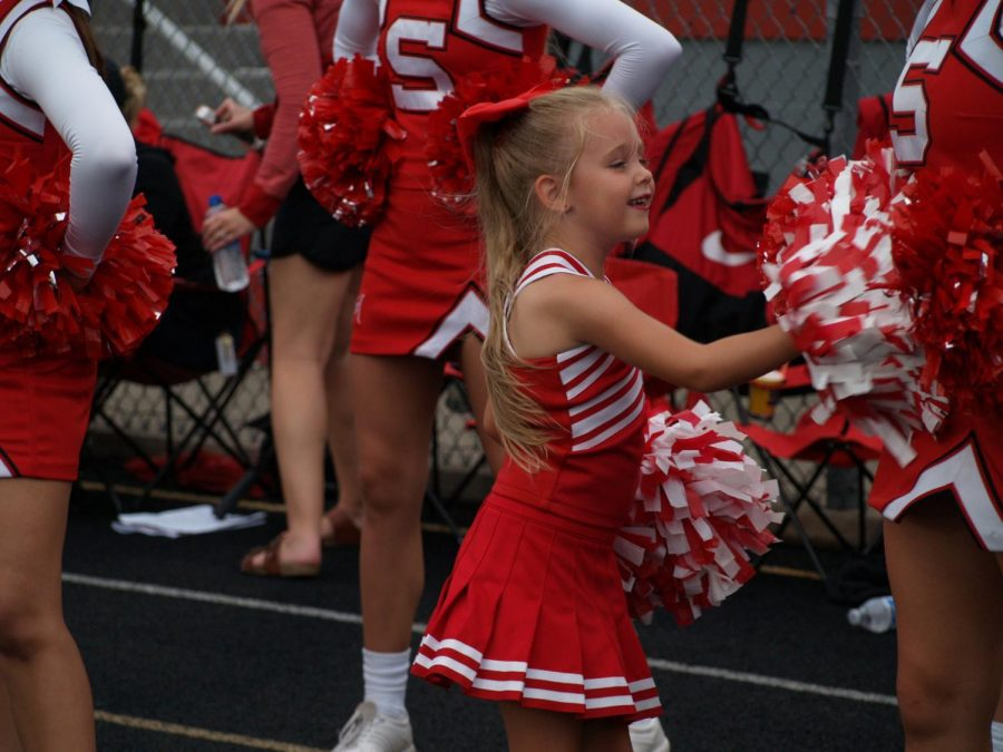 Emma Quinlin cheers with the varsity cheerleaders on Aug. 17.