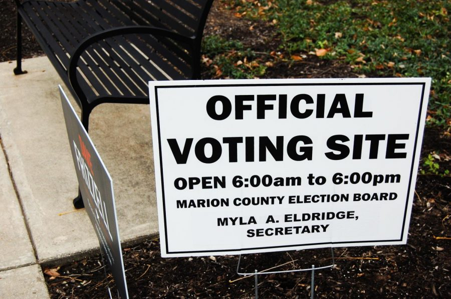 "Sign posted out front of PTEC, identifies it as an ""Official Voting Site"" along with the hours it is open."
