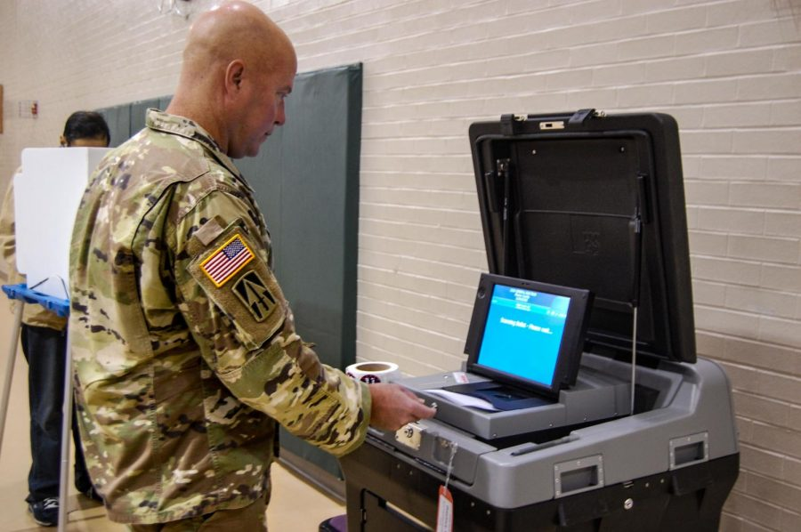 CSM Brown submits a ballot for the 2018 Midterm Election.