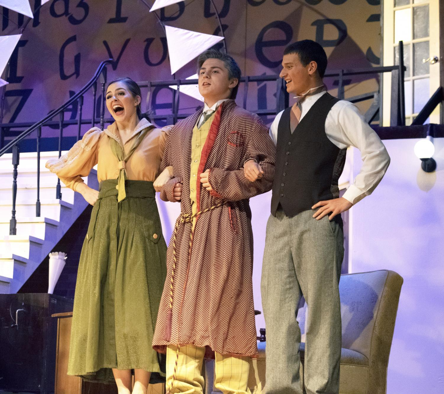(L to R) Juniors Lilly Leslie, Justin Tidd and Jake Warfel sing together during the musical performance of