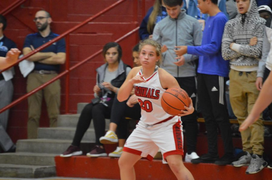 Junior Brynna Reynolds holds the ball in the Lady Cards' game against Perry Meridian on Nov. 20. The Lady Cards lost the game 59-44.