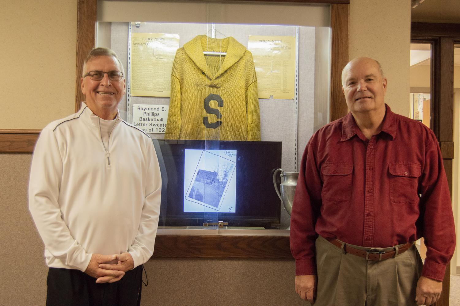 David Ladd (left) and Barry Browning have worked to take care of the SHS Alumni Association Room, which they call a showcase of Southport memorablilia. Both men have collected memorabilia and hope to share their displayed items with the community.