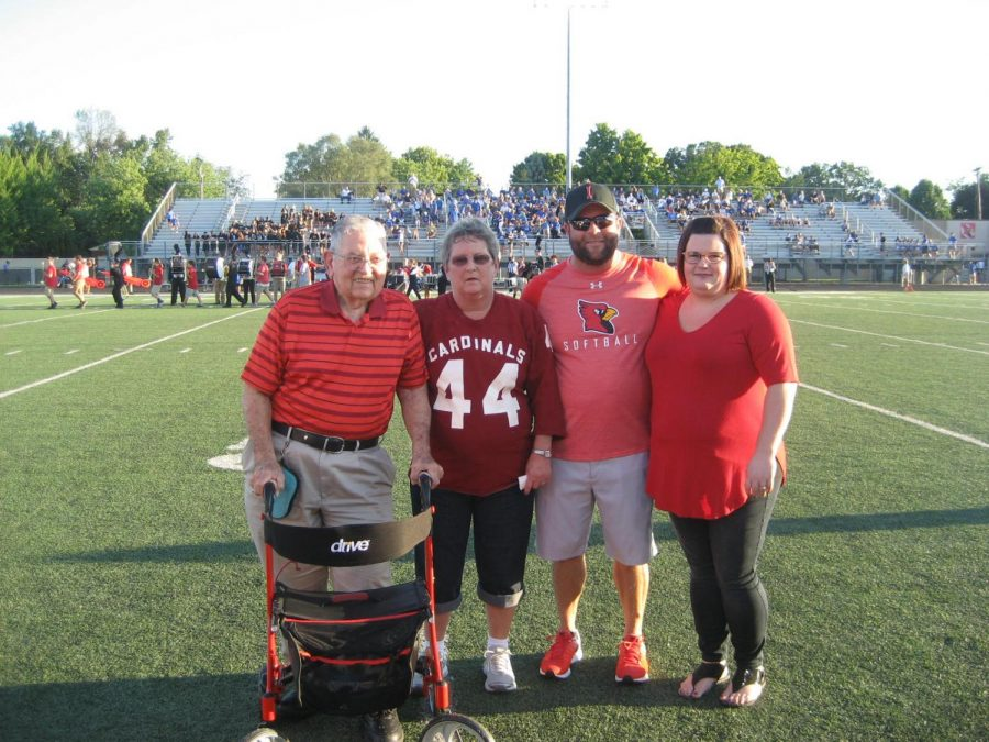 Steve Montgomery's family on the field before his enshrinement plaque was presented on Sept. 14.