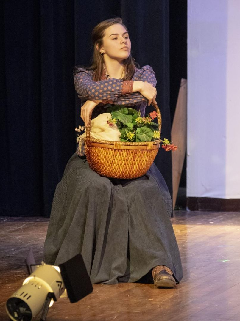 Junior Lilly Leslie, dressed as Eliza Doolittle, acts on stage during a dress rehearsal on Nov. 12. Leslie is the lead in the SHS fall musical,