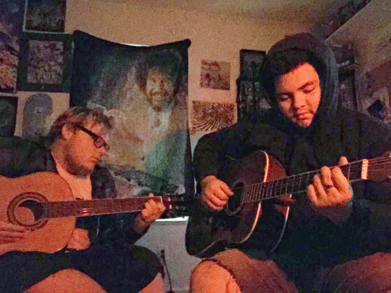 Scott Newton (left) and Denis Shrum sit together and play their music. Newton and Shrum enjoy inspiring others with their lyrics.