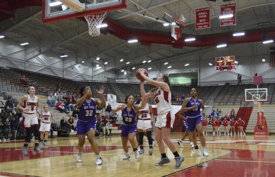 Sophomore Madelyn Newhouse attempts to make a basket in the first quarter of the game. Newhouse scored eight points and got six rebounds.