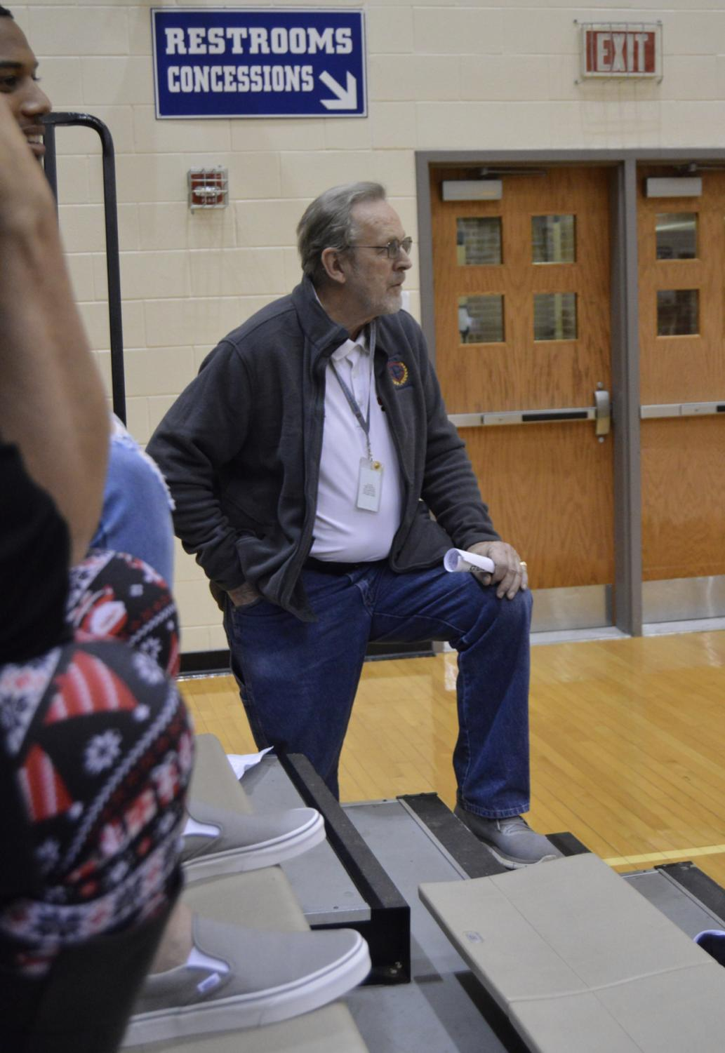 Ben De Boer watches the boys basketball team as they play against Avon on Dec. 21.