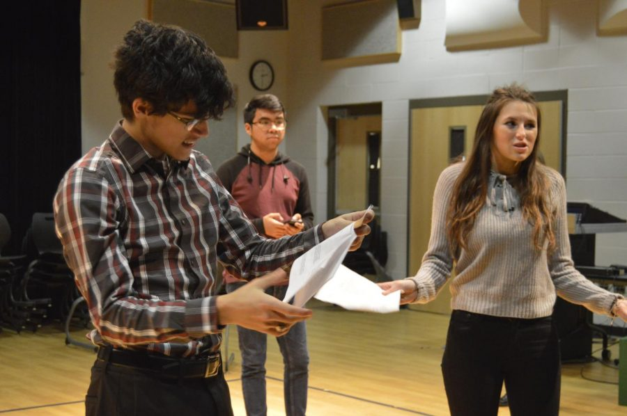 Senior Erik Mendoza and junior Kaitlyn Berry rehearse their lines for their parts in their One Acts skit after school on Dec. 17.