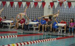Boys swim team dominates Cardinal Classic