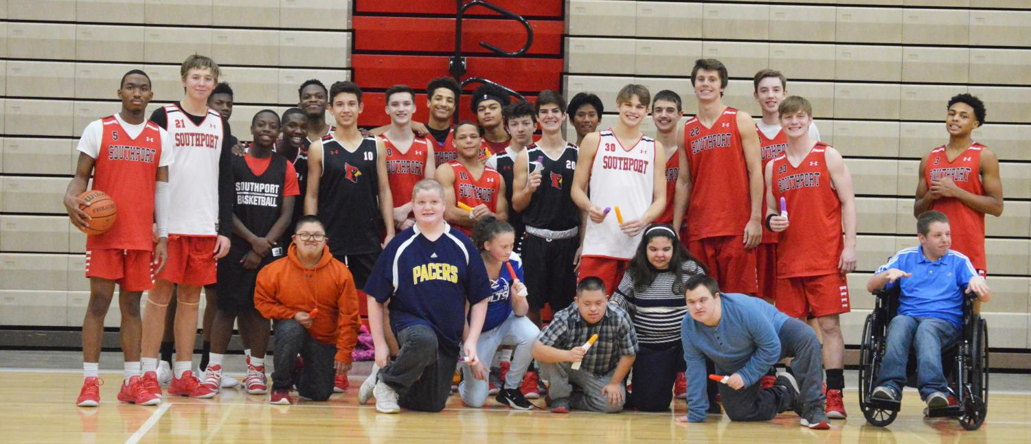 After the buddies and the basketball team finishes their game, they are all given popsicles from the coach.