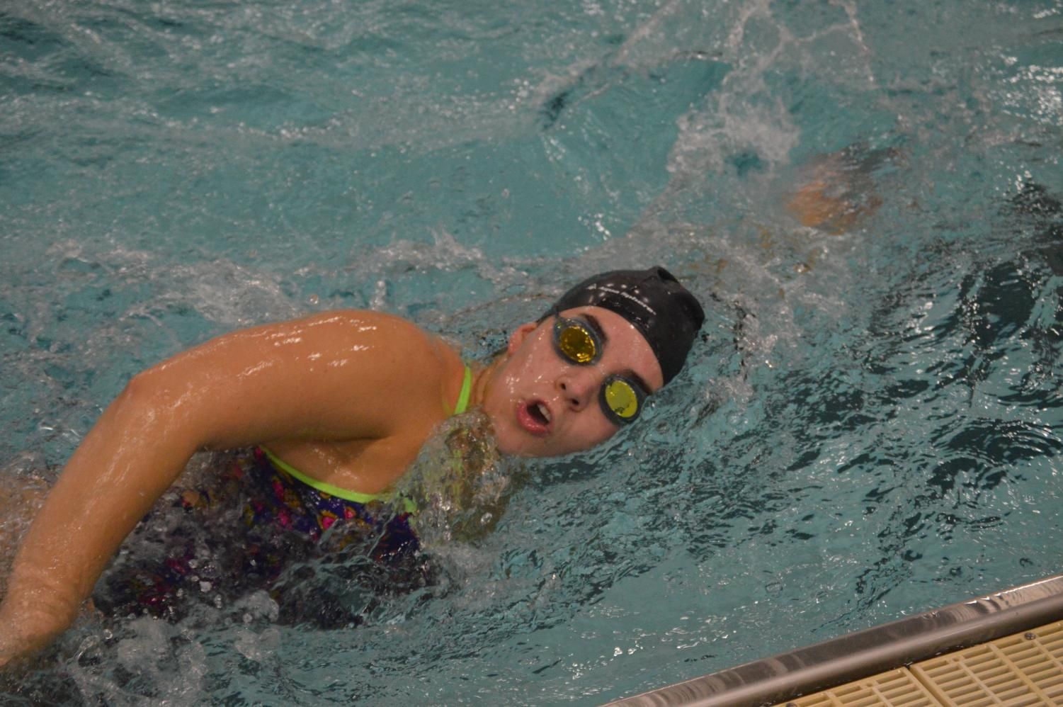 Junior Leslie Anderson swims at a practice on Dec. 17.